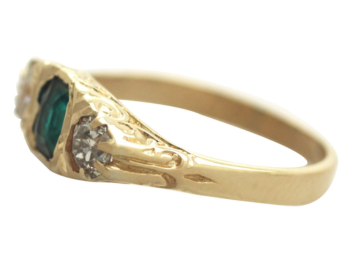 Women's 1910s Antique Emerald and Diamond Yellow Gold Cocktail Ring For Sale