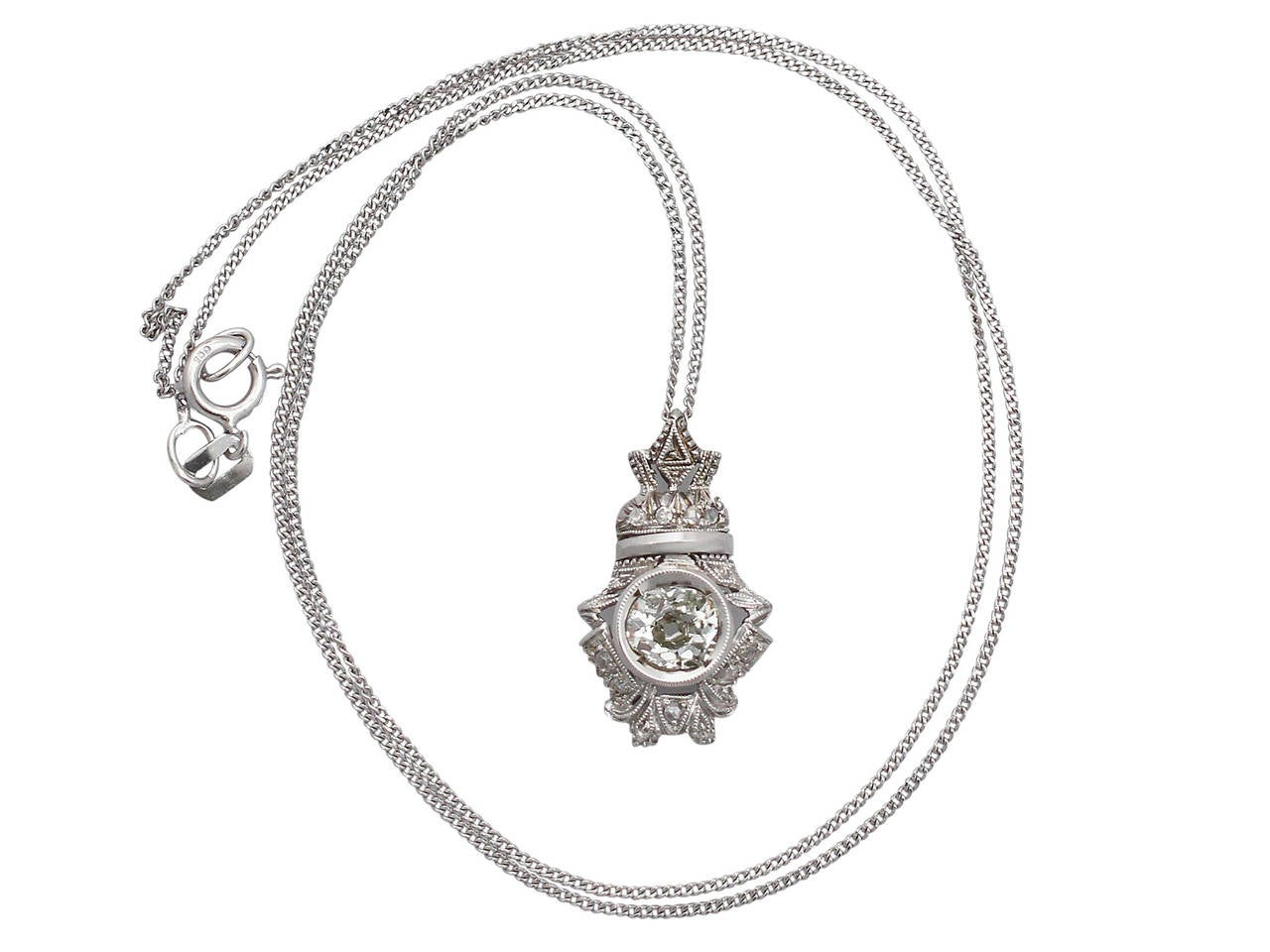 A fine and impressive antique 0.84 carat diamond and 18 karat white gold pendant; part of our diverse diamond jewellery collection.  This fine antique diamond pendant has been crafted in 18 k white gold.  The pierced and millegrain decorated shaped