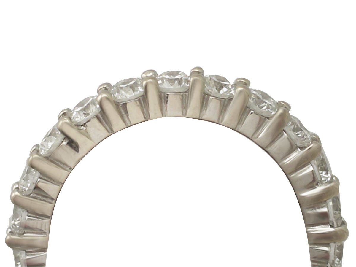 A fine and impressive vintage 3.38 carat diamond and 18 karat white gold full eternity ring; part of our vintage jewelry and estate jewelry collections  This impressive diamond eternity ring has been crafted in 18k white gold.  The white gold,