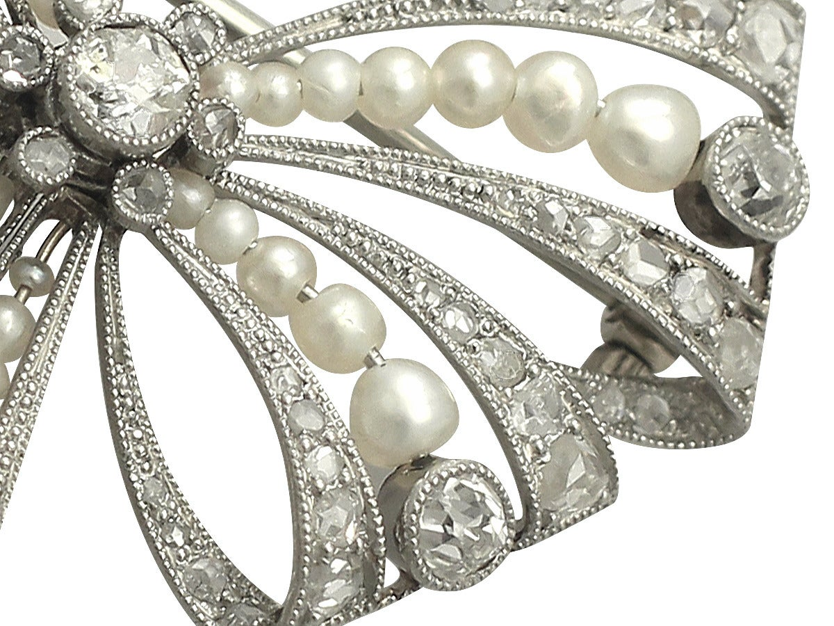 Pearl and 0.68Ct Diamond, Platinum Bow Brooch - Antique Victorian In Excellent Condition In Jesmond, Newcastle Upon Tyne