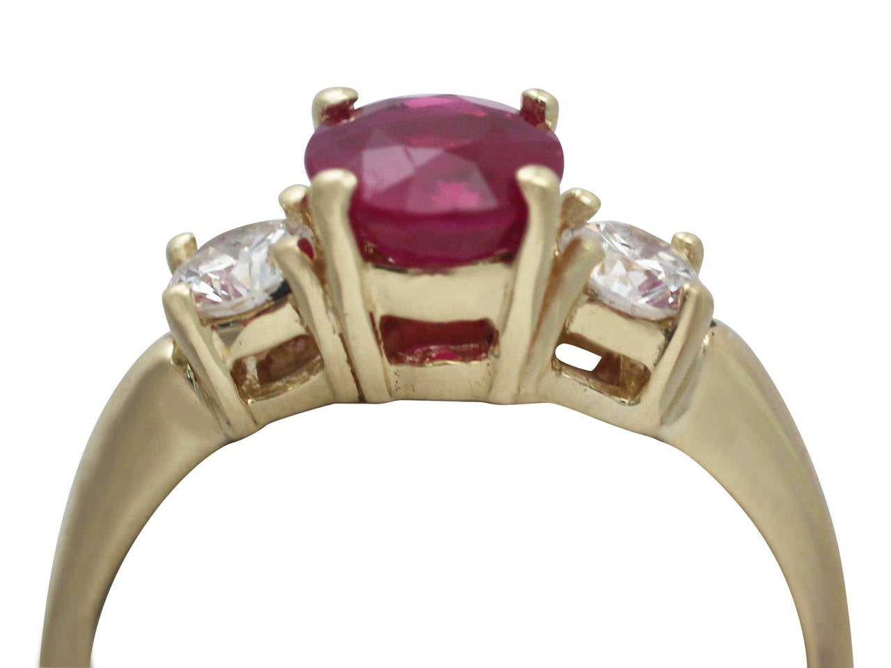 A fine and impressive contemporary 1.32 carat natural ruby and 0.46 carat diamond, 18 karat yellow gold three stone/trilogy ring; an addition to our contemporary jewelry and estate jewelry collections  This fine and impressive ruby and diamond