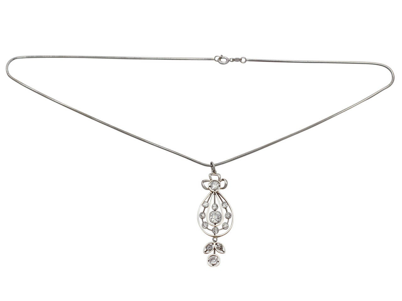 A stunning, fine and impressive antique Victorian 2.14 carat diamond, 15 karat yellow gold, platinum set pendant; part of our diverse collection of antique jewelry and estate jewelry  This stunning antique diamond pendant has been crafted in 15k