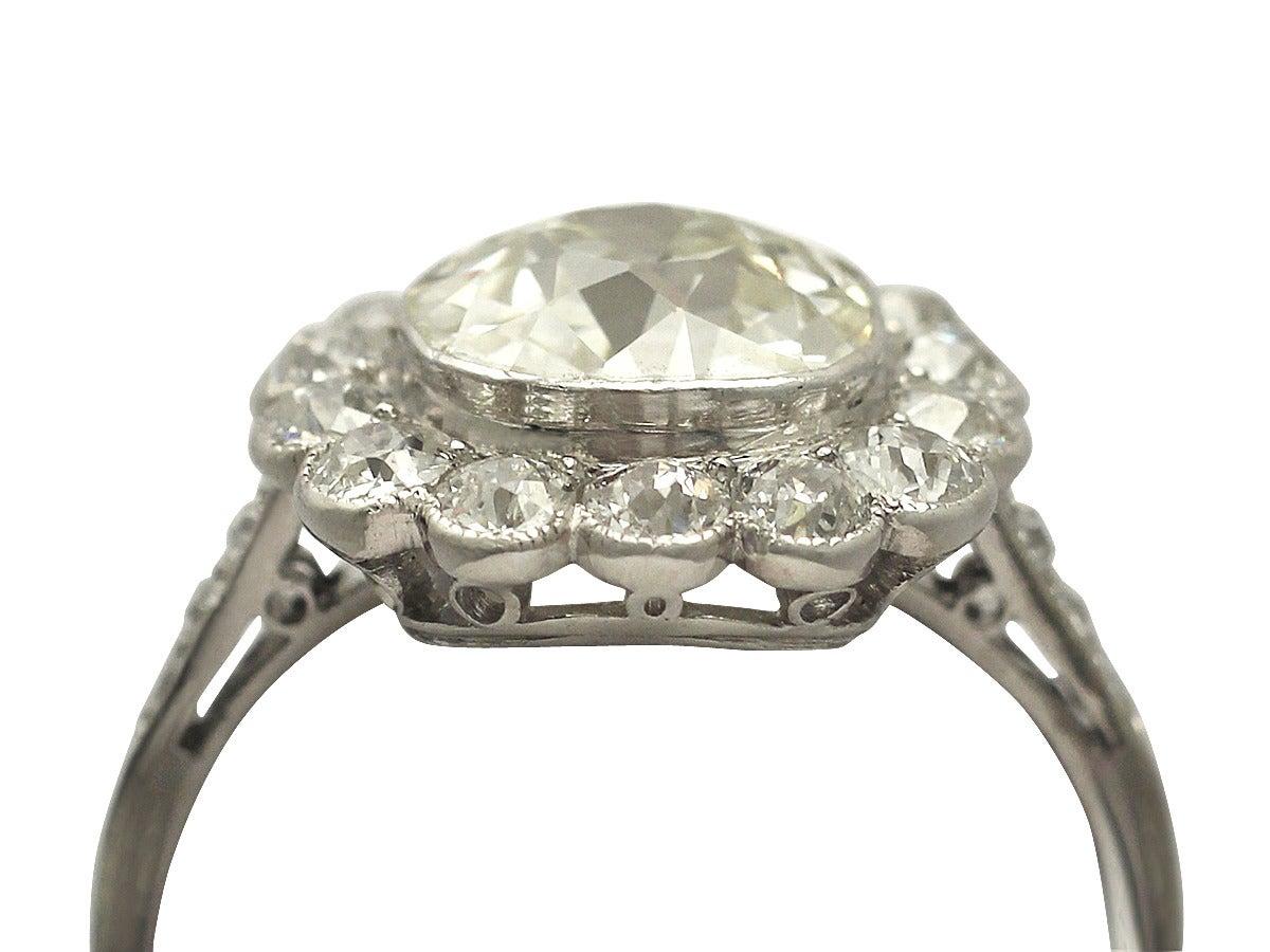 1910s 4.47 Carat Diamond and Platinum Cluster Ring  2