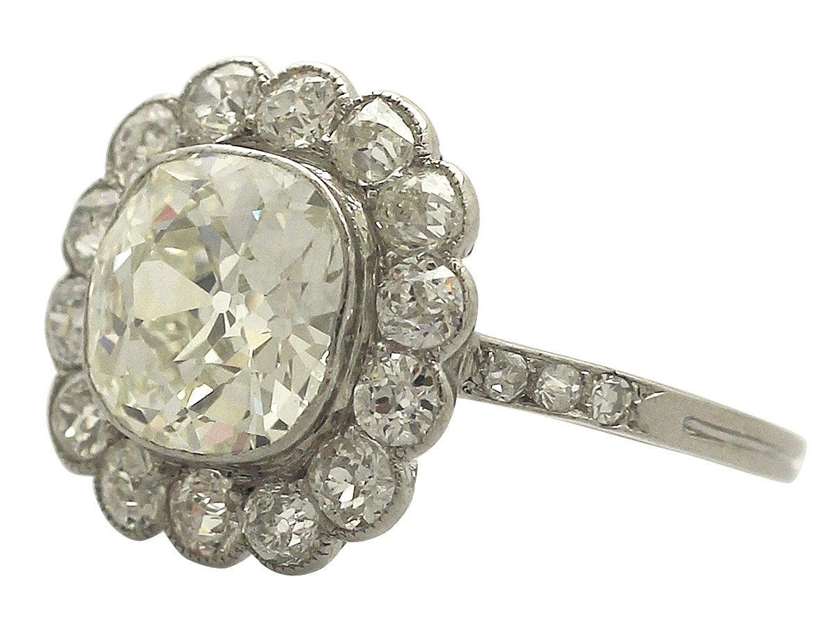 1910s 4.47 Carat Diamond and Platinum Cluster Ring  3