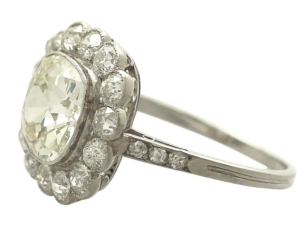 1910s 4.47 Carat Diamond and Platinum Cluster Ring  4