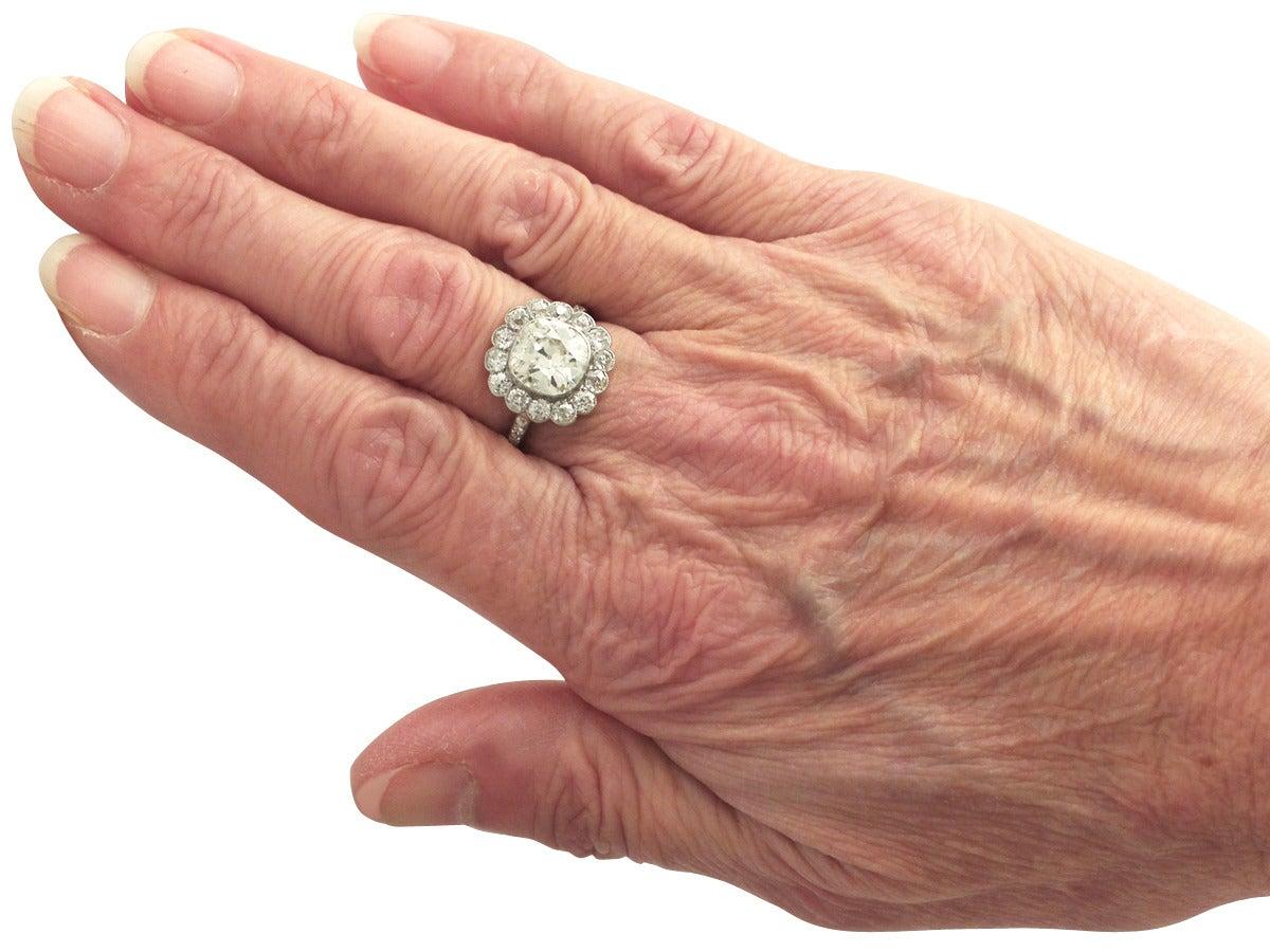 1910s 4.47 Carat Diamond and Platinum Cluster Ring  6