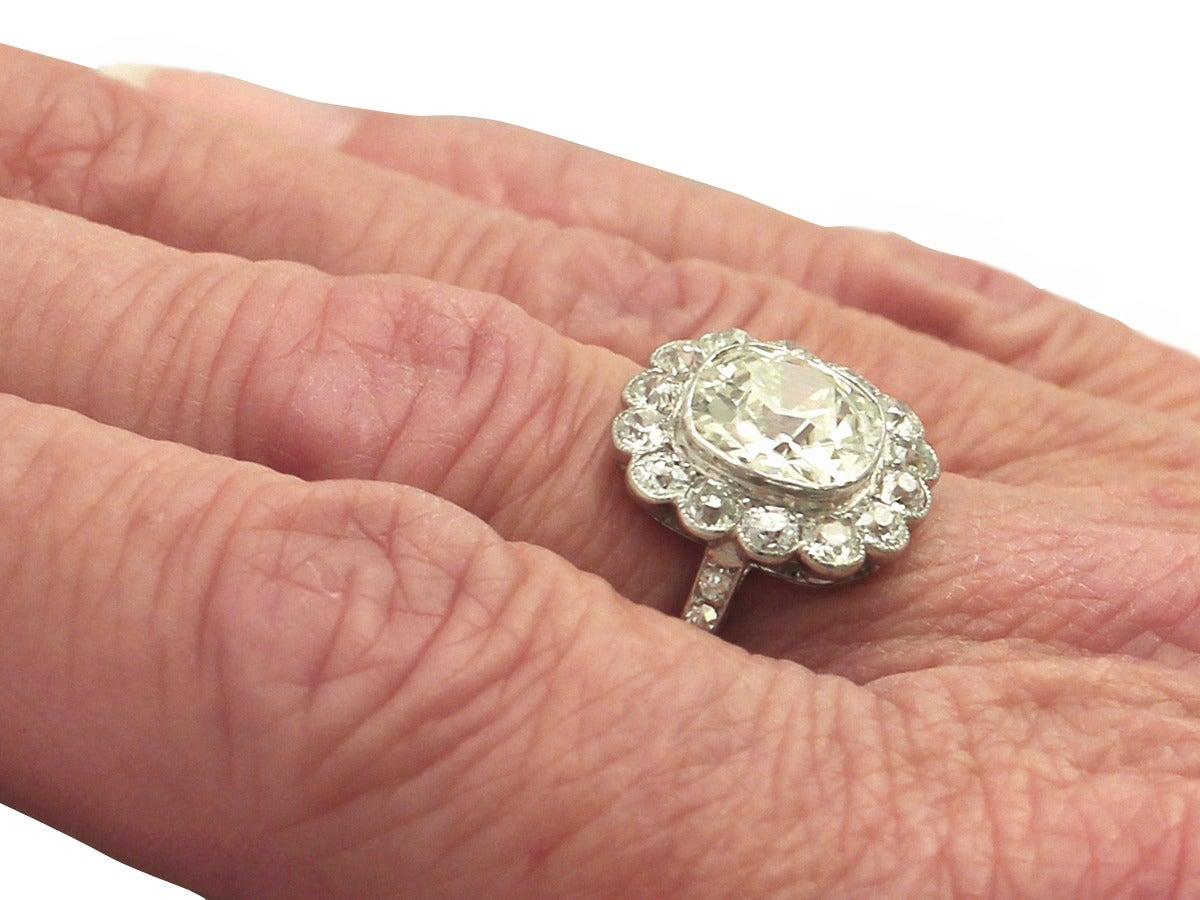 1910s 4.47 Carat Diamond and Platinum Cluster Ring  7