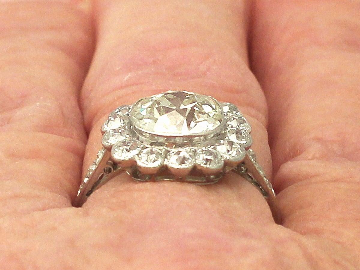 1910s 4.47 Carat Diamond and Platinum Cluster Ring  8