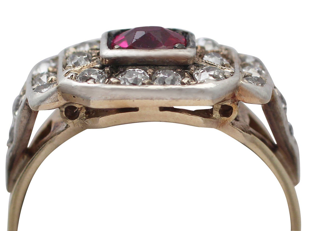 A fine and impressive antique 0.60 carat natural ruby and 0.59 carat diamond, 14 karat yellow gold, 14 karat white gold set dress ring; part of our antique jewelry and estate jewelry collections  This impressive antique ruby and diamond ring has