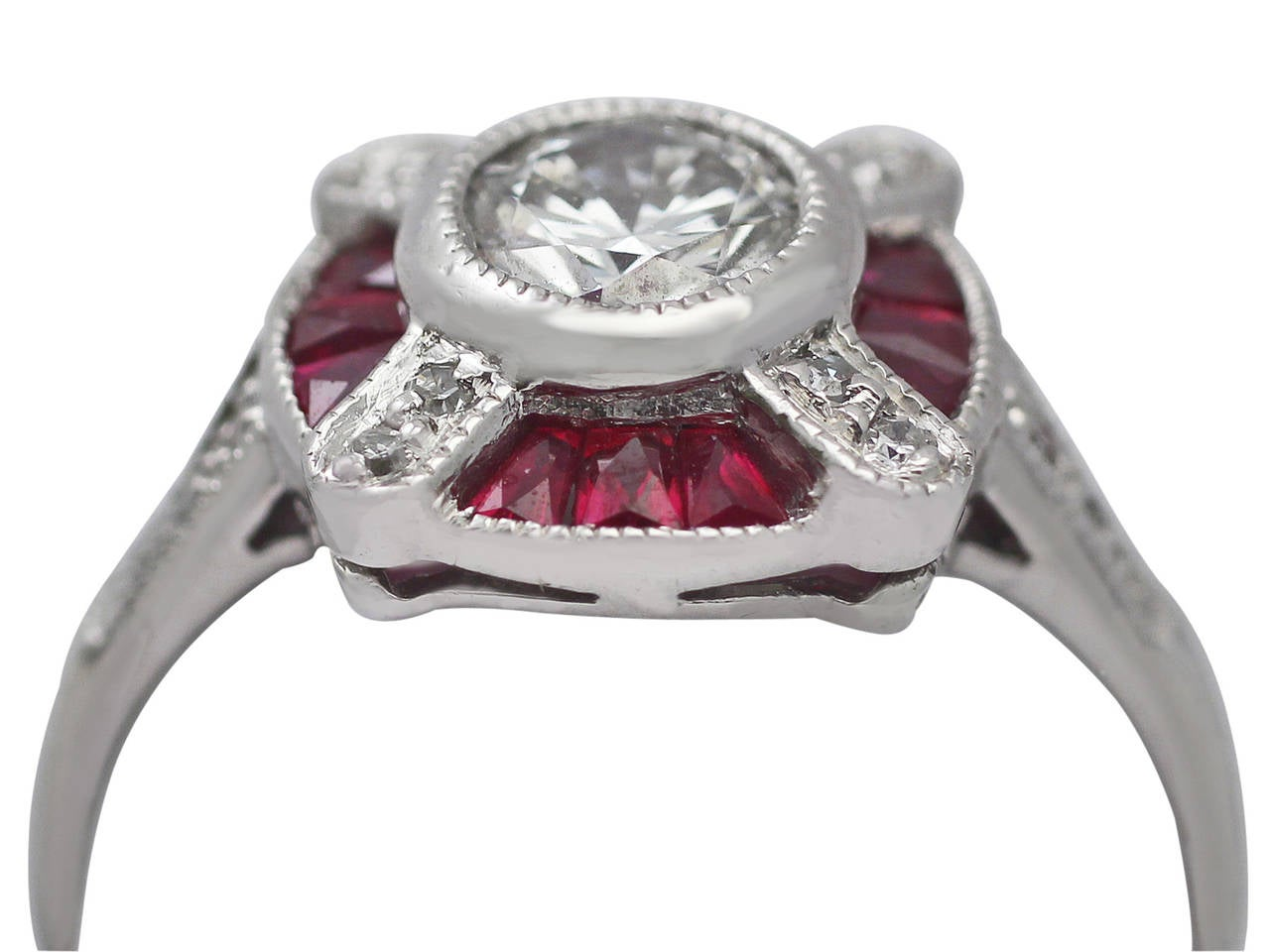 A stunning, fine and impressive vintage 0.75 carat diamond and 0.34 carat natural ruby, platinum dress ring in the Art Deco style; part of our vintage jewellery and estate jewelry collections  This stunning 1940s ring has been crafted in platinum in