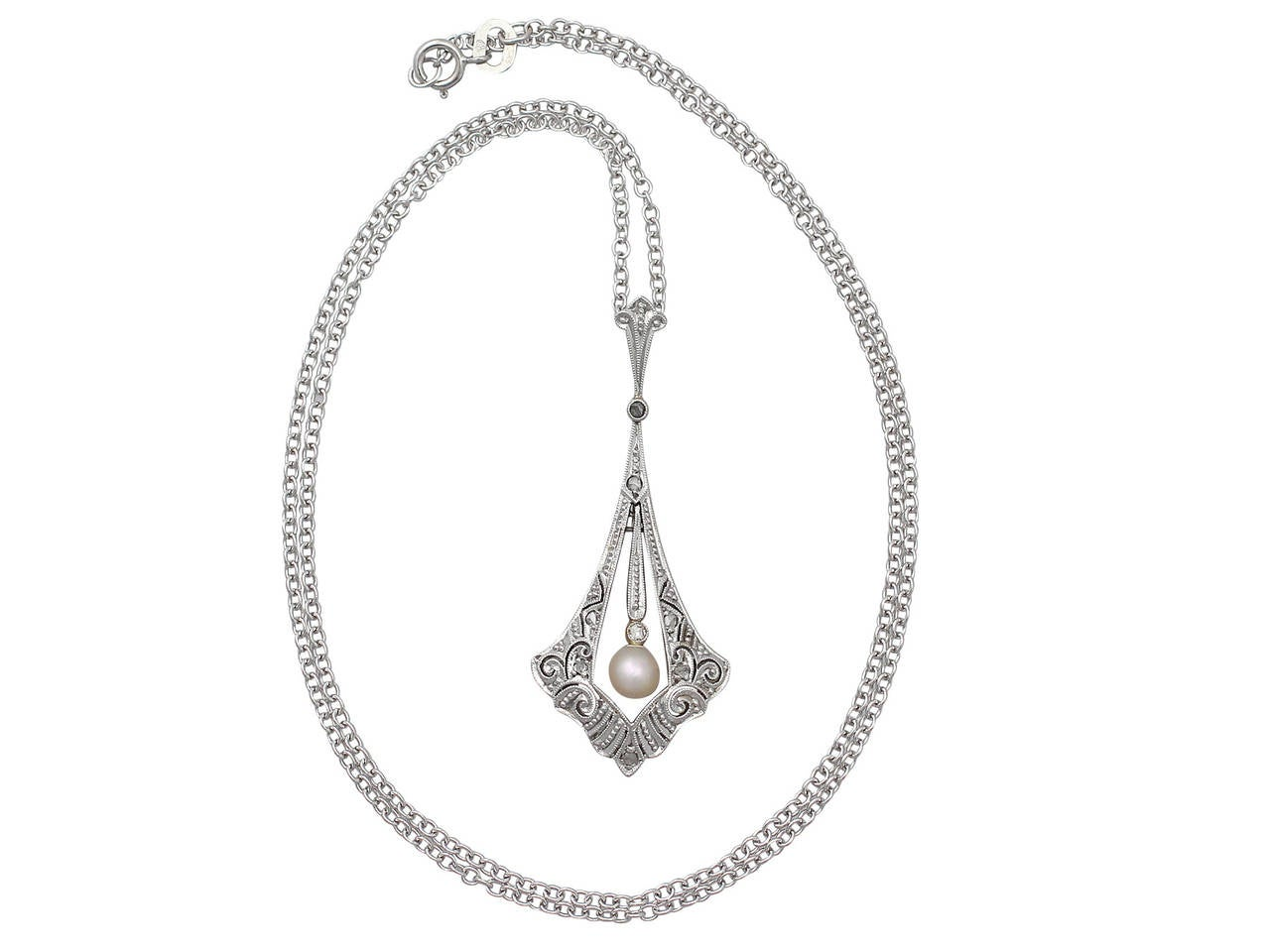 A fine and impressive antique 0.10 carat diamond and pearl 14 karat yellow gold, platinum set pendant; part of our diverse antique diamond jewelry and estate jewelry collections  This impressive diamond and pearl pendant has been crafted in 14k