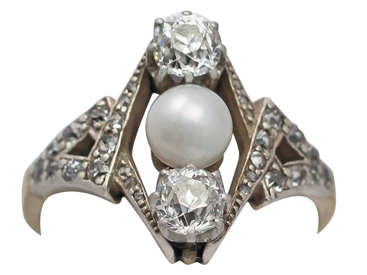A fine and impressive antique 1.15 carat diamond and cultured pearl, 18k yellow gold, platinum set dress ring; part of our antique jewelry and estate jewelry collections.  This impressive antique diamond and pearl ring has been crafted in 18k yellow