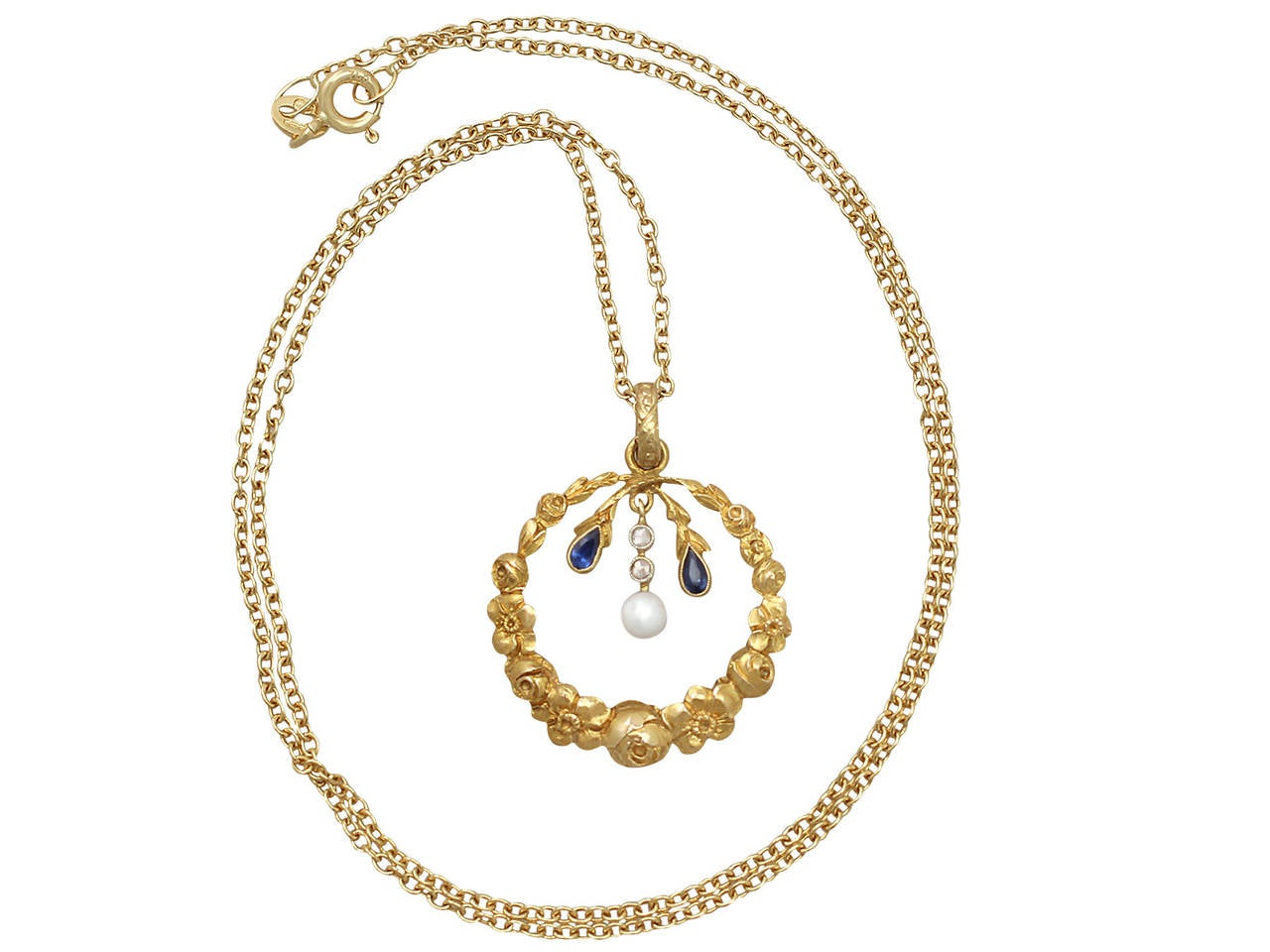A fine antique pearl, 0.06 carat sapphire and 0.04 carat diamond, 14 karat yellow gold pendant; part of our antique jewelry and estate jewelry collections  This fine antique sapphire pendant has been crafted in 14k yellow gold.  The pendant has a
