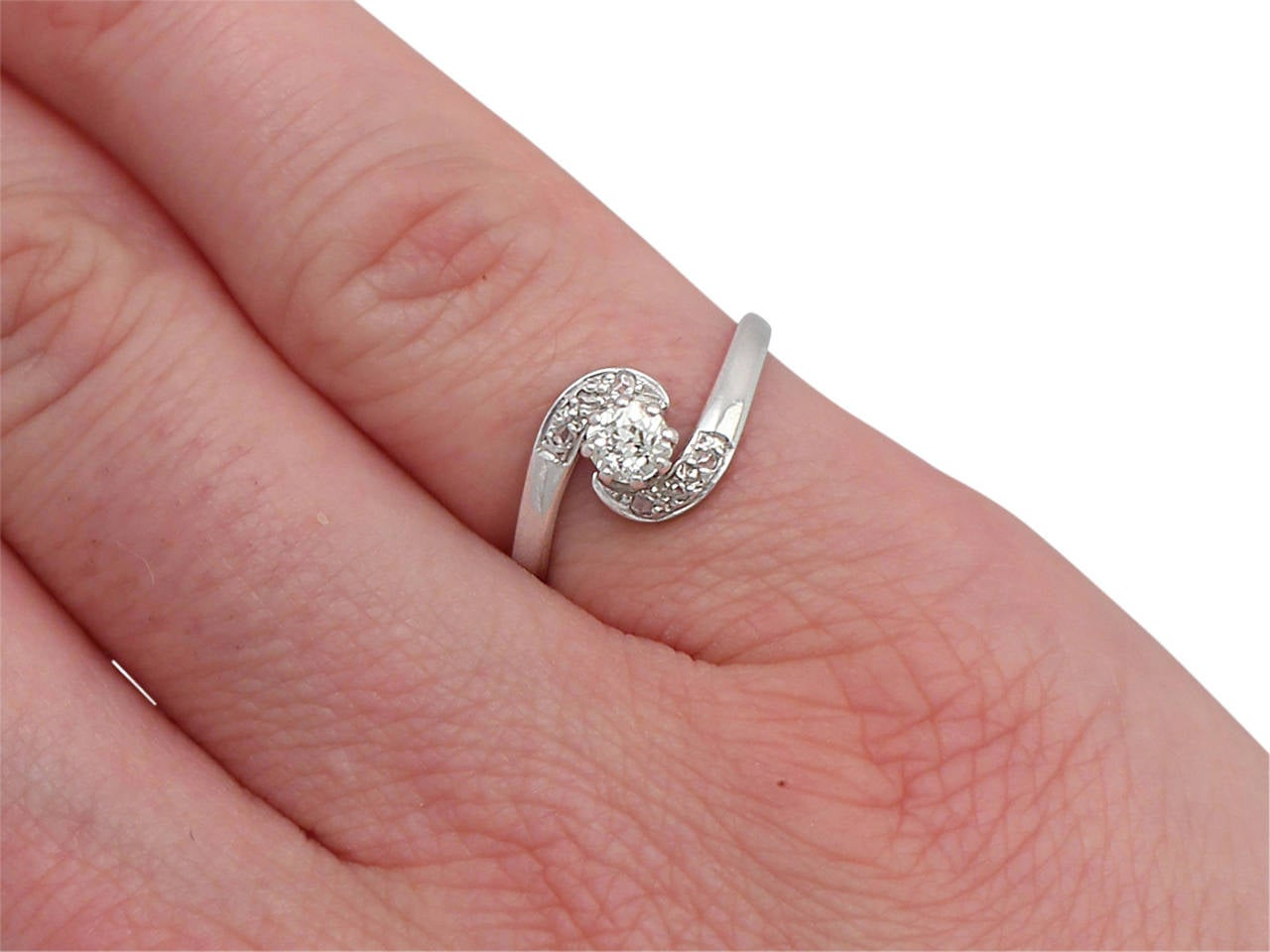 1985 Diamond and Platinum Twist Ring For Sale at 1stdibs