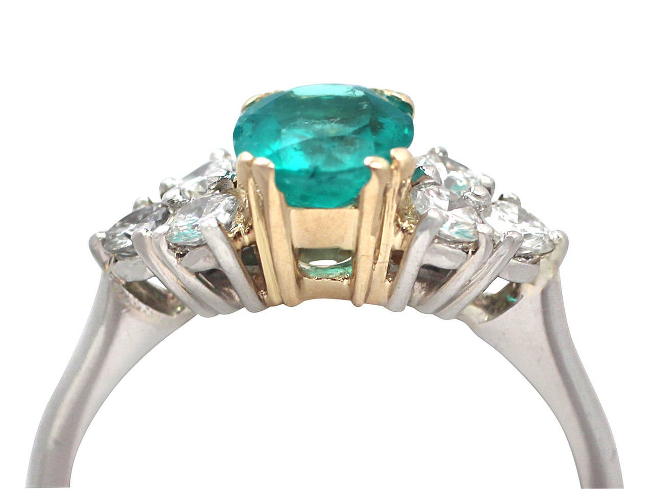 1990s 1.06 Carat Emerald and Diamond Platinum Cocktail Ring 2