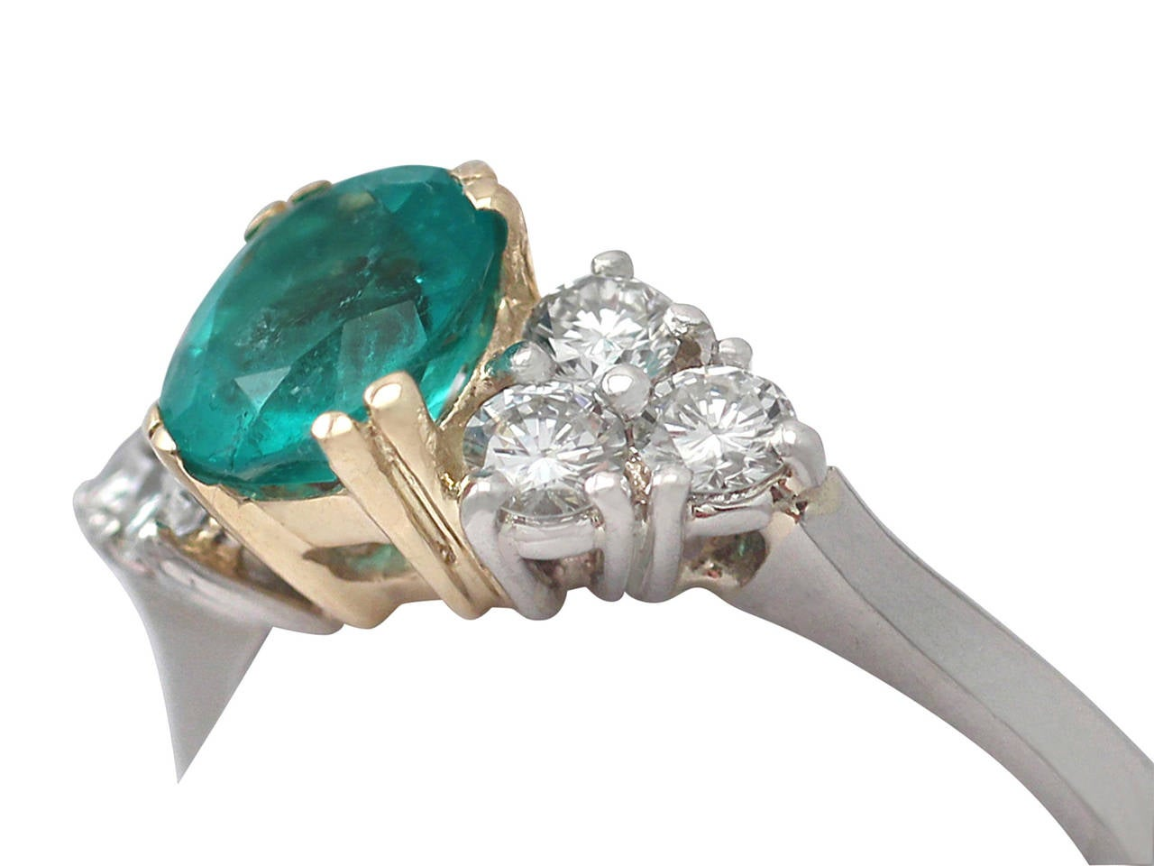 1990s 1.06 Carat Emerald and Diamond Platinum Cocktail Ring 3