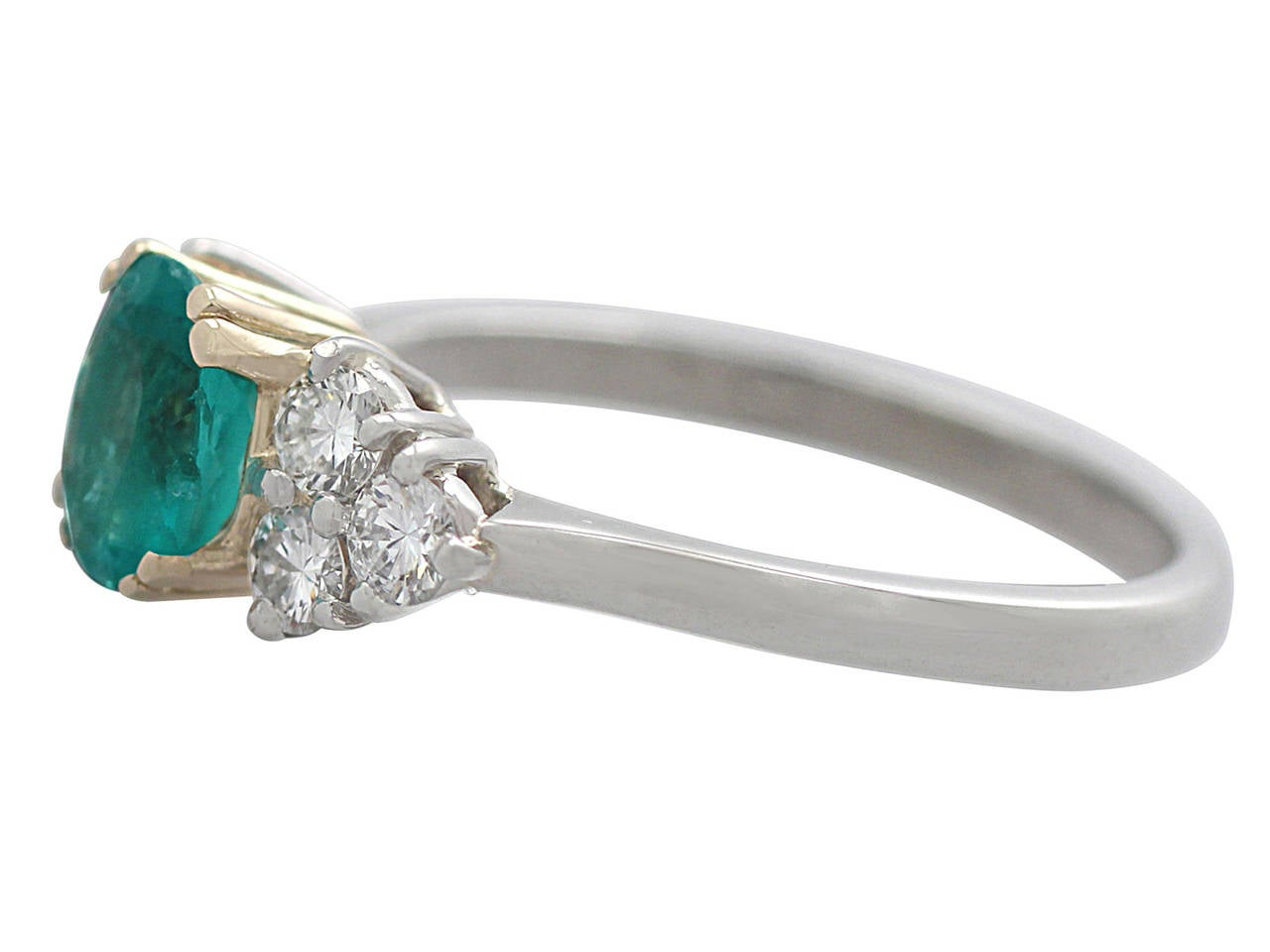 1990s 1.06 Carat Emerald and Diamond Platinum Cocktail Ring 4