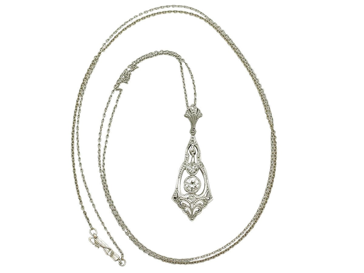 A fine and impressive antique 0.44 carat diamond and 14 karat white gold Art Deco pendant; part of our diverse antique diamond jewelry and estate jewelry collections.  This impressive Art Deco pendant has been crafted in 14 k white gold.  The