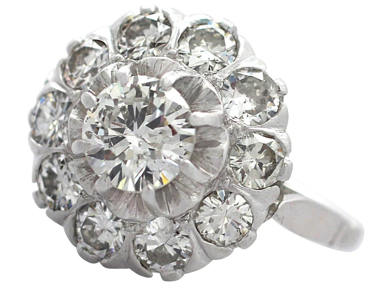 A stunning, fine and impressive antique 1.35 carat diamond and 18 carat white gold cluster ring; part of our vintage jewelry and estate jewelry collections  This stunning vintage diamond cluster ring has been crafted in 18k white gold.  The pierced