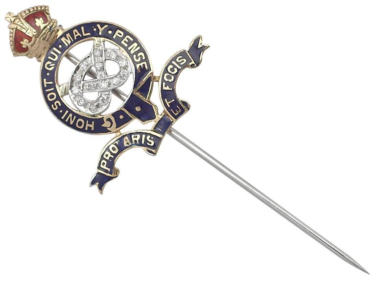 A fine 0.14 carat diamond and enamel vintage Staffordshire Yeomanry, WWII pin brooch in 18 karat yellow gold; part of our diverse collection of military related items  This fine vintage Forces WWII pin brooch has been crafted in 18k yellow