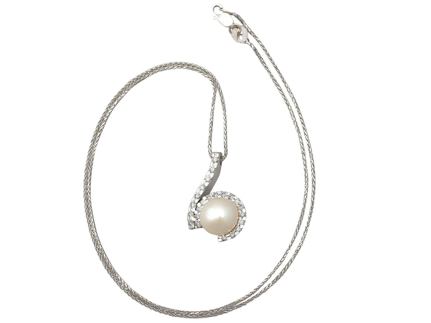 1 27ct and pearl 18k white gold earring and