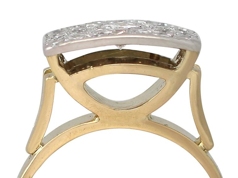 A fine and impressive vintage 1.06 carat diamond, 18 karat yellow gold and 18 karat white gold set dress ring in the Art Deco style; part of our diamond jewelry and estate jewelry collections