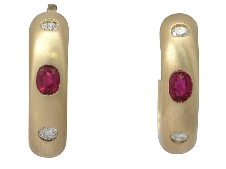 A fine and impressive vintage 18 karat yellow gold, 1.05 carat natural ruby and 0.44 carat diamond jewelry set (brooch and earrings); part of our gemstone jewelry and estate jewelry collections  This fine and impressive vintage jewelry set,