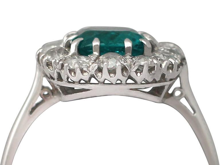 1910s Antique 1.62 Carat Emerald & Diamond Platinum Cluster Ring 2