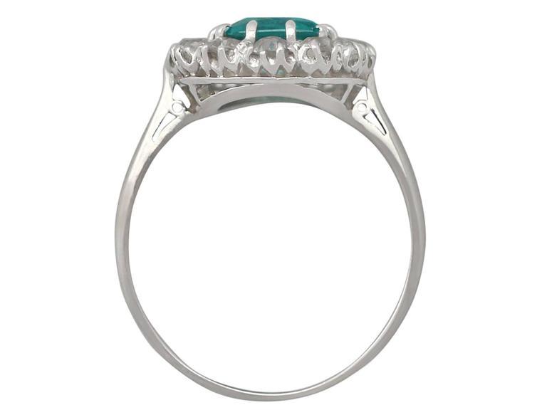 1910s Antique 1.62 Carat Emerald & Diamond Platinum Cluster Ring 5