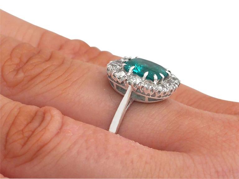 1910s Antique 1.62 Carat Emerald & Diamond Platinum Cluster Ring 8