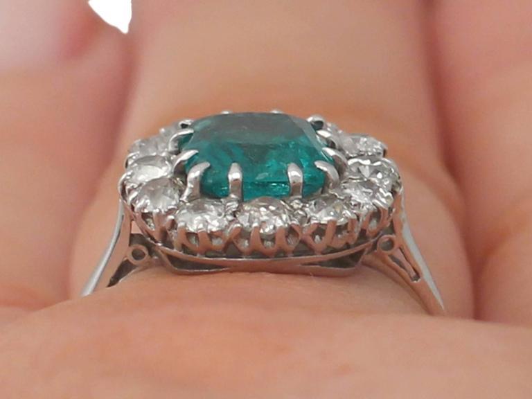 1910s Antique 1.62 Carat Emerald & Diamond Platinum Cluster Ring 9