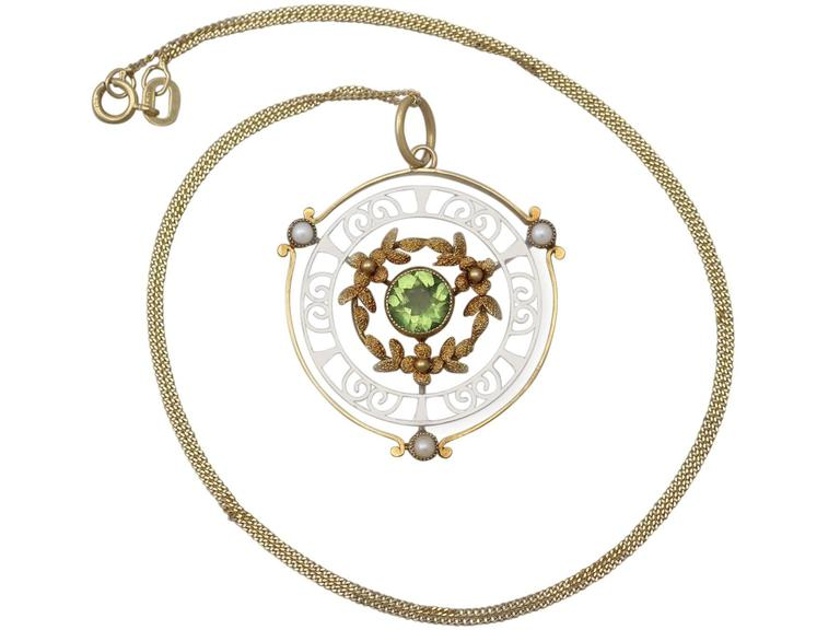 A fine and impressive antique 0.85 carat natural peridot and seed pearl, 15 karat yellow gold, 15 karat white gold pendant; part of our antique jewelry and estate jewelry collections  This fine and impressive antique pendant has been crafted in 15k