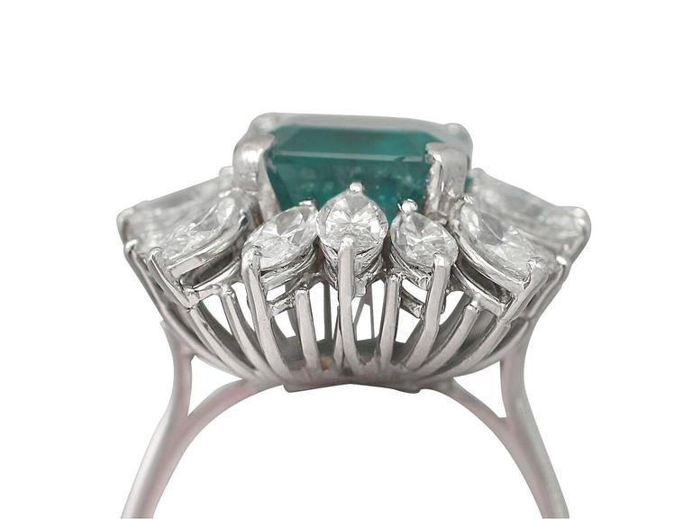 A stunning, fine and impressive vintage 4.30 carat natural emerald and 3.24 carat diamond, 18 karat white gold cluster ring; an addition to our vintage jewelry and estate jewelry collections  This stunning, fine and impressive emerald and diamond