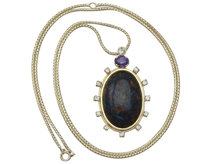 An exceptional, stunning, fine and impressive vintage boulder opal, 1.52 carat sapphire and 1.28 carat diamond, 18 karat yellow gold pendant with a 14 karat yellow gold snake chain; part of our diverse vintage jewelry and estate jewelry