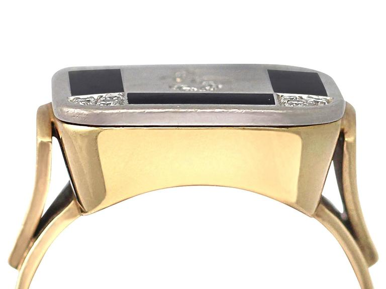 A stunning, fine and impressive 0.20 carat diamond and black enamel, 14 karat yellow gold and 14 karat white gold set, vintage ring; part of our vintage jewelry and estate jewelry collections