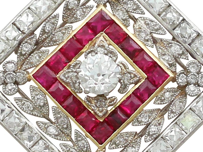 A magnificent and exceptional antique 3.48 carat diamond and 0.53 carat ruby, platinum and 18 karat yellow gold pendant / brooch; part of our diverse antique jewelry collections.  This magnificent, fine and impressive ruby and diamond pendant/brooch