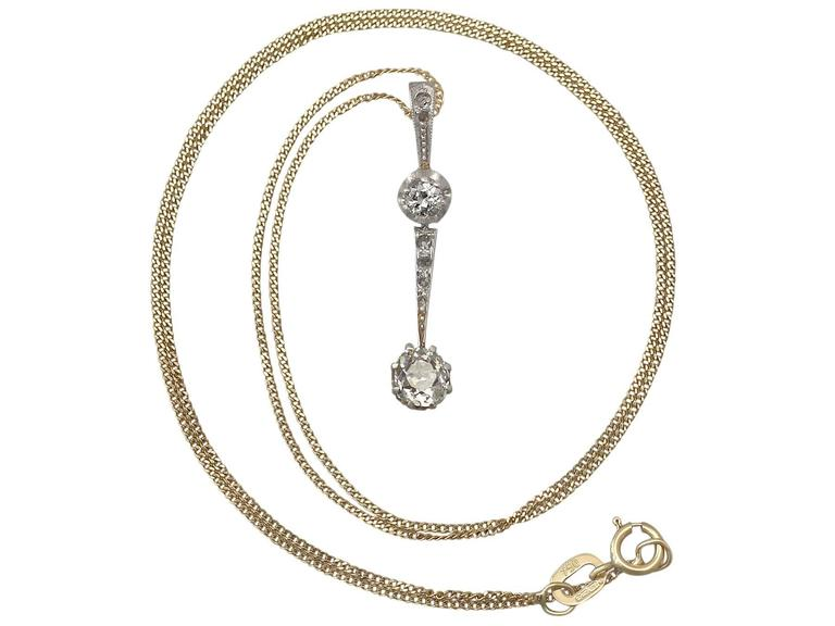 A fine and impressive antique 0.50 carat diamond and 18 karat white gold pendant; part of our diverse antique jewelry and estate jewelry collections  This fine and impressive antique diamond pendant has been crafted in 18k white gold with 18k yellow