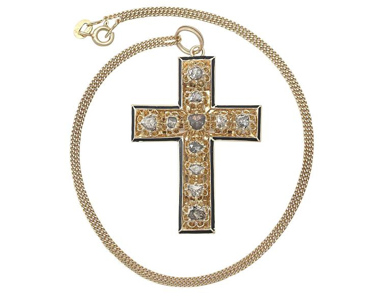 A stunning, fine and impressive antique Victorian 1.42 carat diamond, black enamel and 14 karat yellow gold cross pendant; part of our diverse antique jewelry and estate jewelry collections  This stunning, fine and impressive Victorian cross pendant