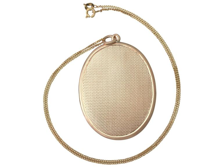 A fine and impressive antique Victorian 9 karat yellow gold locket pendant ; part of our diverse antique jewelry and estate jewelry collections  This fine and impressive, large antique locket has been crafted in 9k yellow gold.  The hinged locket