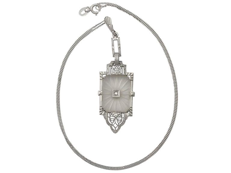 A fine and unusual antique 0.02 carat diamond and crystal, 14 karat white gold Art Deco pendant; part of our diverse antique jewelry and estate jewelry collections  This fine and impressive antique pendant has been crafted in 14k white gold.  The