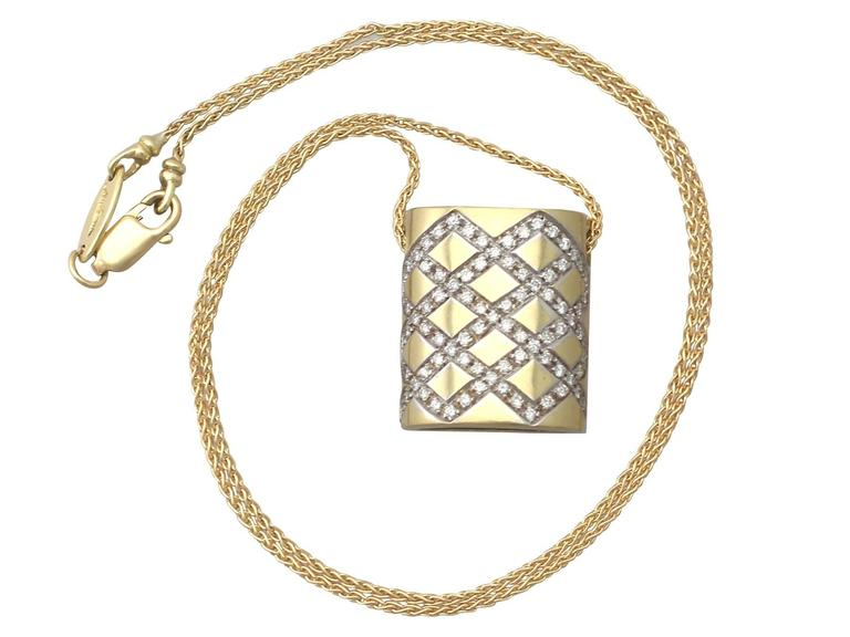 A fine and impressive vintage Belgian 0.65 carat diamond and 18 karat yellow gold, 18 karat white gold set pendant; part of our vintage jewelry and estate jewelry collections  This fine and impressive vintage pendant has been crafted in 18k yellow