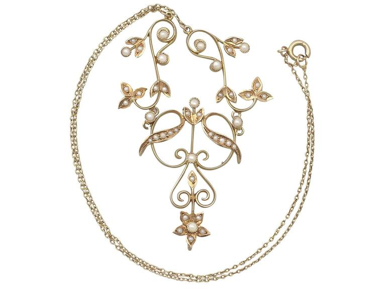 A fine and impressive antique seed pearl necklace in 14 karat yellow gold; part of our diverse antique jewelry and estate jewelry collections  This fine and impressive seed pearl necklace has been crafted in 14k yellow gold.  This pearl embellished