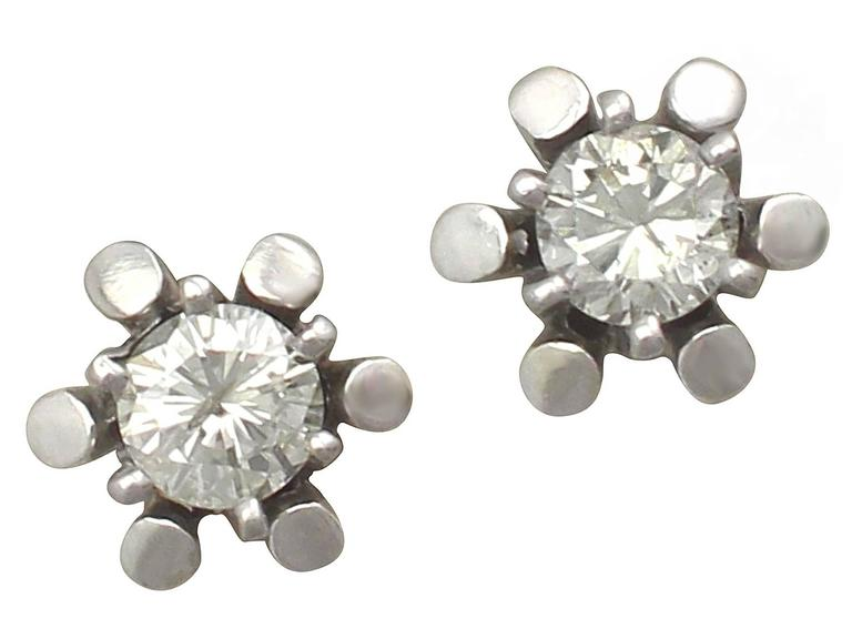 A fine and impressive pair of vintage 0.48 carat modern brilliant round cut diamond, 14 karat white gold stud earrings; part of our diverse vintage jewelry and estate jewelry collections  These fine and impressive vintage German diamond stud