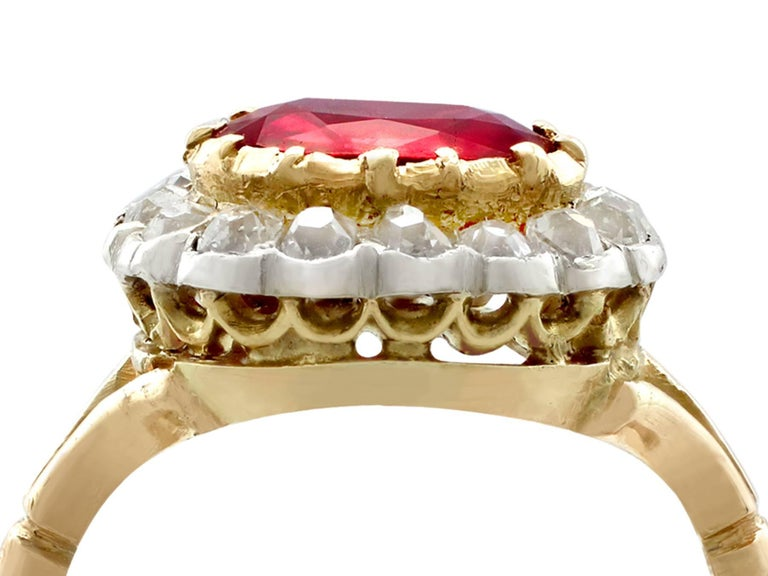 A stunning, fine and impressive antique 1.50 carat ruby and 0.60 carat diamond, 18 karat yellow gold, 18 karat white gold set cluster ring; part of our antique jewelry and estate jewelry collections  This stunning, fine and impressive antique ruby