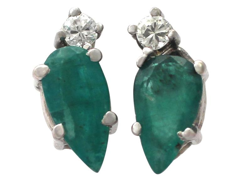A fine and impressive pair of vintage 1.04 carat natural emerald and 0.05 carat diamond, 18 karat white gold stud earrings; part of our diverse vintage jewelry and estate jewelry collections  These fine and impressive vintage emerald stud earrings