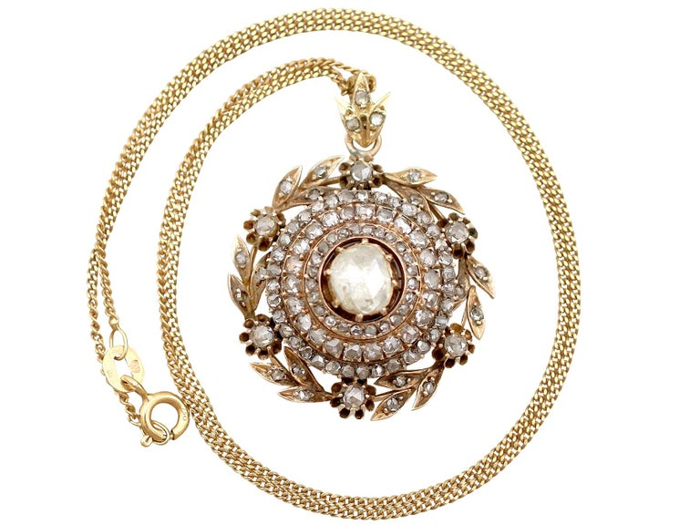 A stunning, fine and impressive antique Victorian 2.95 carat diamond (total) and 14 karat yellow gold pendant; part of our diverse antique jewelry and estate jewelry collections  This stunning, fine and impressive antique diamond pendant has been