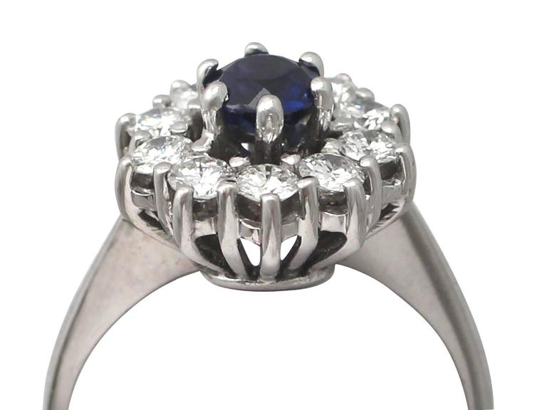 A fine and impressive 0.46 carat natural blue sapphire and 0.45 carat diamond (total), 18 karat white gold cluster ring; part of our vintage jewelry and estate jewelry collections  This fine and impressive vintage sapphire and diamond cluster ring
