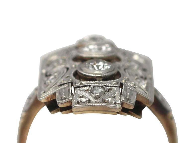 A fine and impressive antique Art Deco 0.88 carat diamond and 14 karat yellow gold, 14 karat white gold set dress ring; part of our diverse antique jewelry collections  This fine and impressive antique Art Deco diamond ring has been crafted in 14k