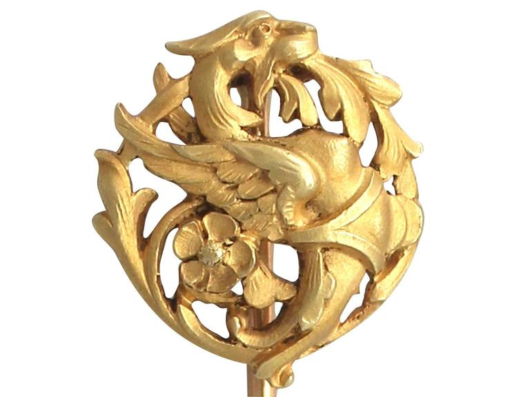 A fine and impressive antique French 18 karat yellow gold pin brooch in the form of a dragon; part of our collection of animal related jewelry collection