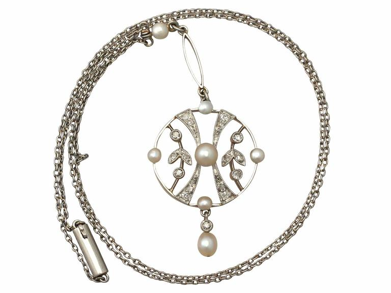 A fine and impressive 0.24 carat diamond and seed pearl, 14k yellow gold and platinum set pendant; part of our diverse antique jewellery and estate jewelry collections  This fine and impressive antique pendant as been crafted in 14k yellow gold with